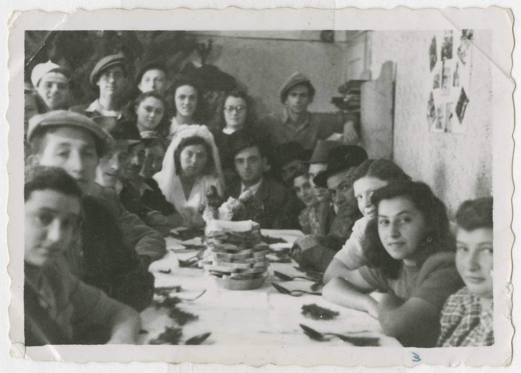 Members of Kibbutz Bnei Akiva celebrate the wedding of two of its members.  Sziku Smilovic is pictured standing on the right.  The other men all from Munkacz are Mojshe, Zelig, Josef Klein, Jack Reiss and Sender.