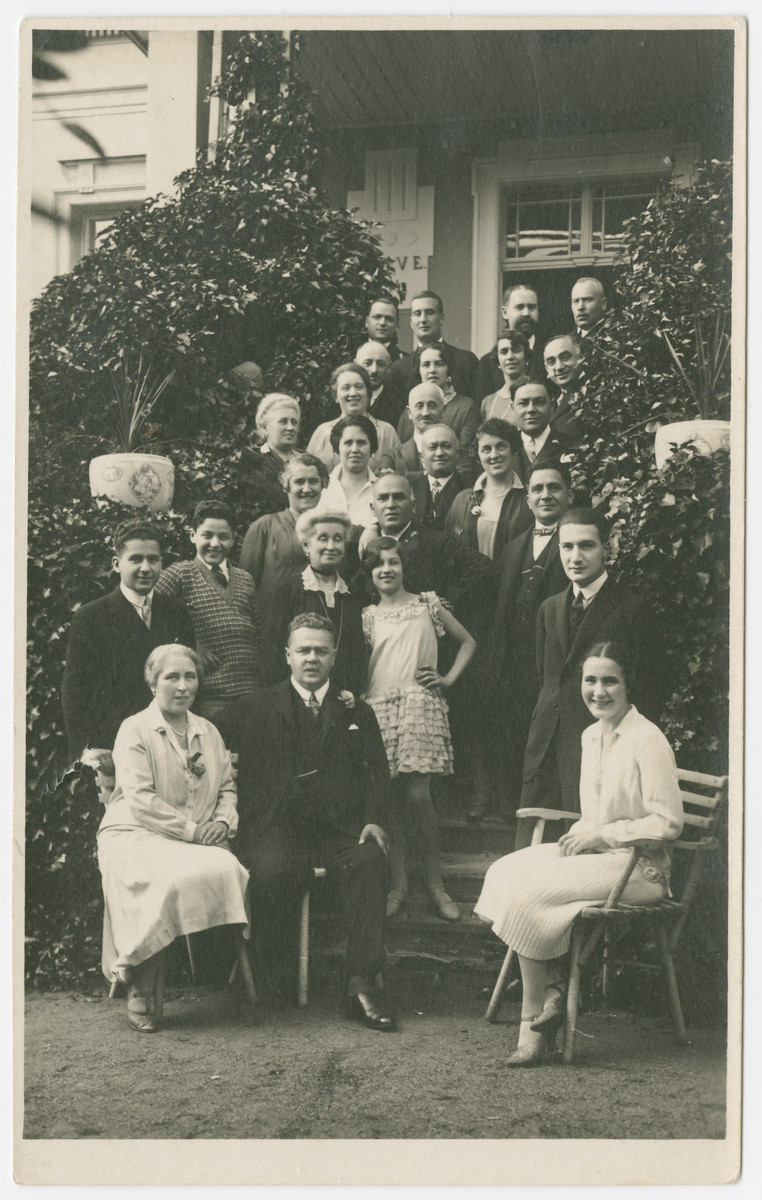 Group family portrait taken to celebrate the engagement of Vilma Eisenstein and Kurt Grunwald.  Matilda and Otto Eisenstein (Vilma's parents) are seated on the left.  Vilma Eisenstein is seated on the right.  Her fiance, Kurt Grunwald is standing behind her.