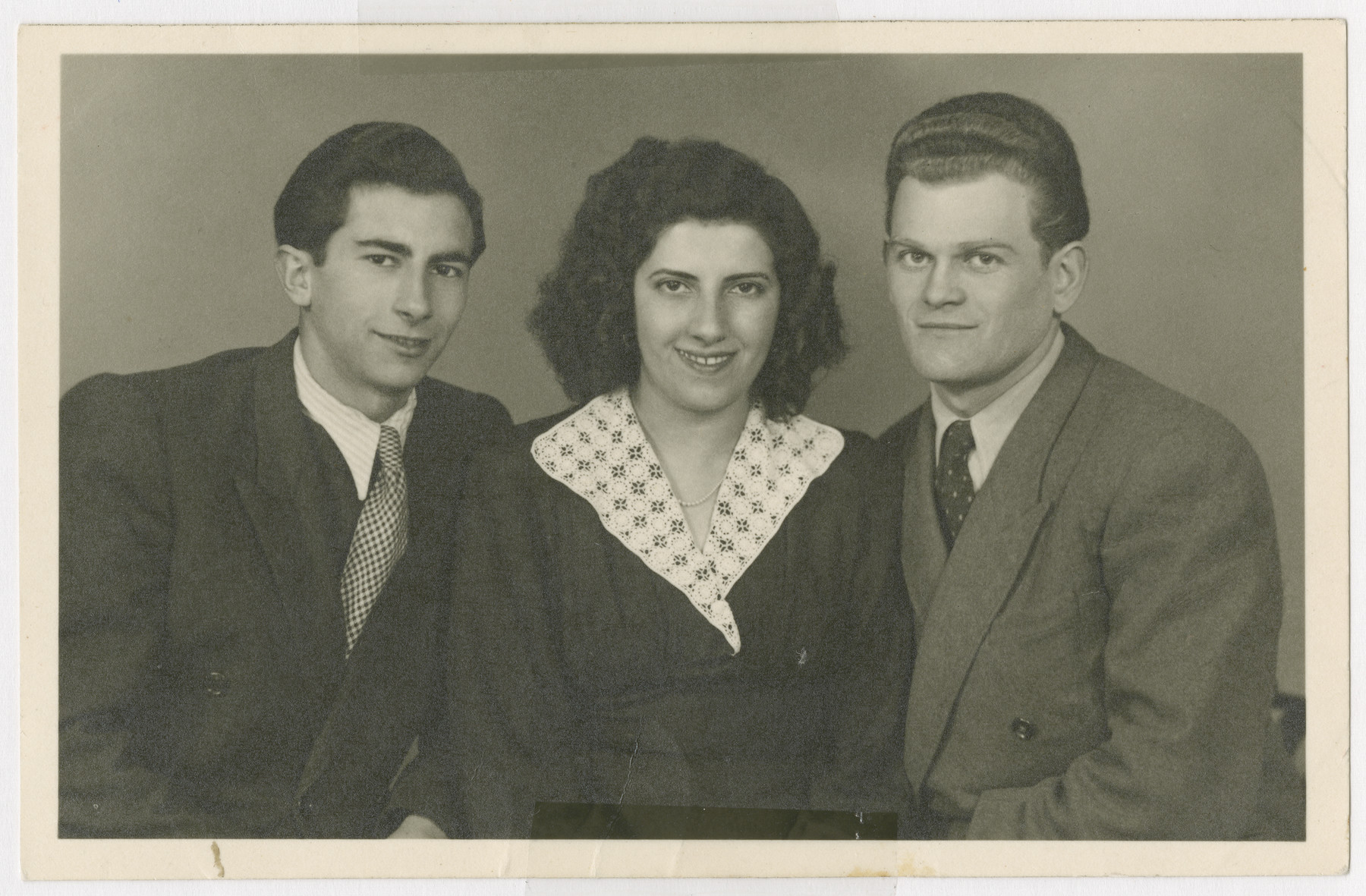 Sziku Smilovic (left) poses for a studio portrait with his sister and brother-in-law, Heddy and Arthur Spitz, prior to their immigration to the United States.