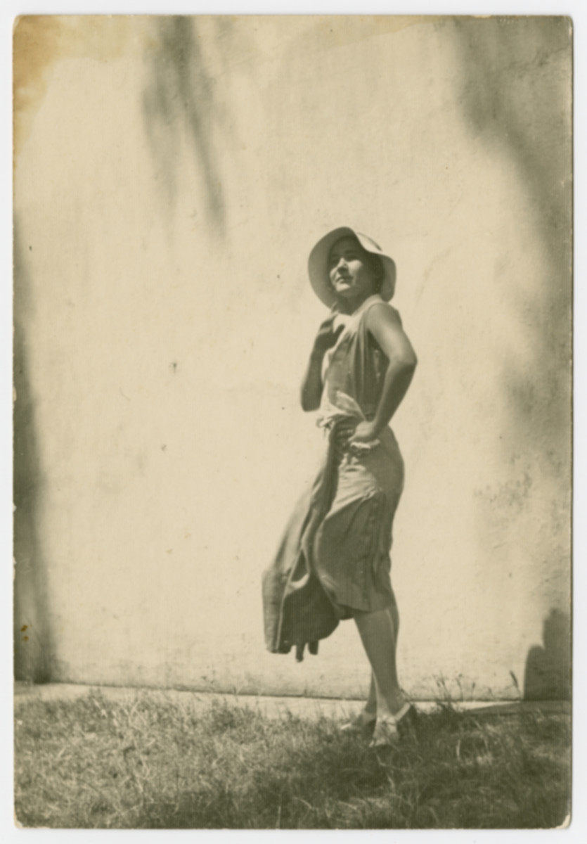 Portrait of Vilma Grunwald taken outside with her dress blowing in the wind.