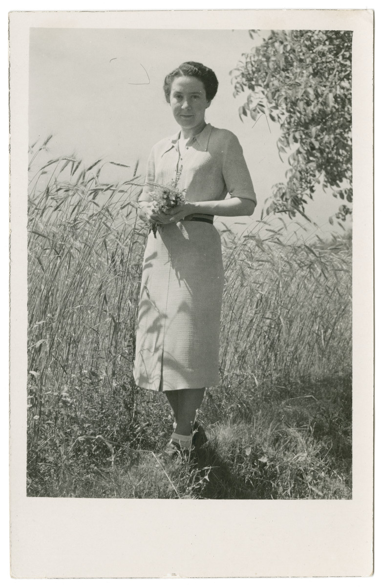 Close-up portrait of Vilma Eisenstein Grunwald standing in front of a wheat field,.