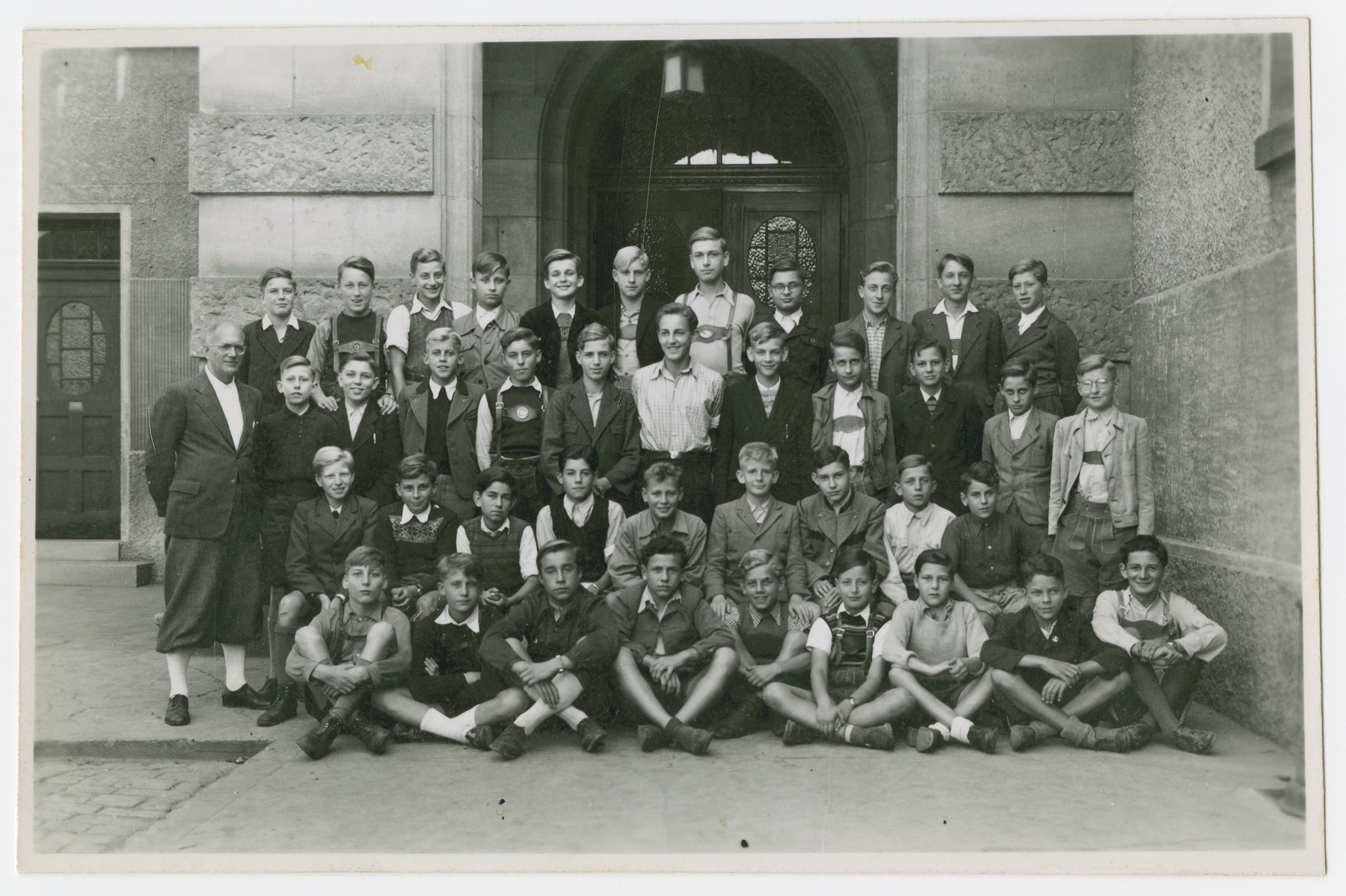 Group portrait of boys in a school in poswar Esslingen, Germany.  Jerzy Ogurek is seated at the bottom right.  He was the only Jew in his class.