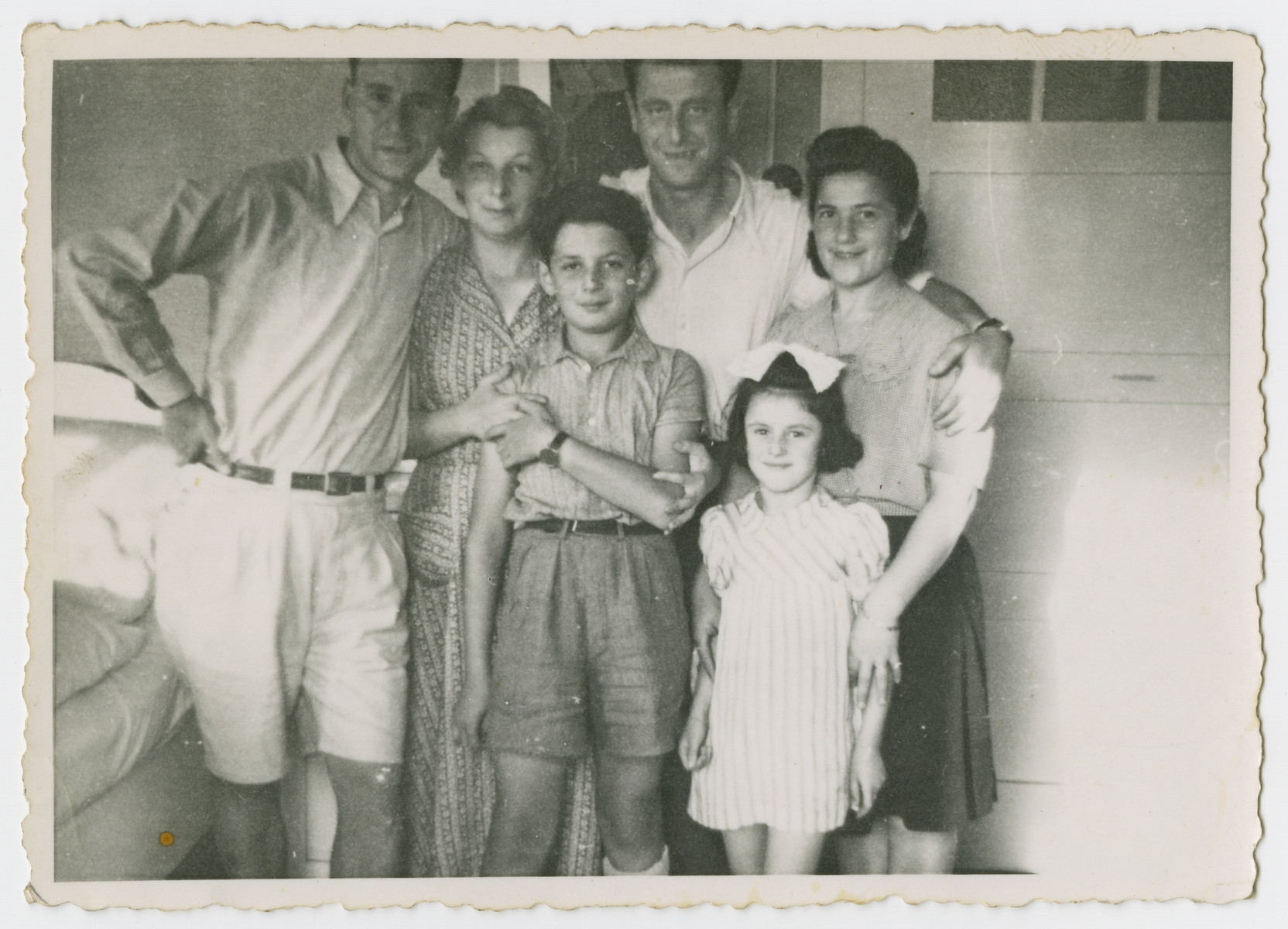 Postwar group portrait of the Zimmerman family.  From left to right are Chaskiel Zimmerman, Karola Ogurek Zimmerman, Jerzy Ogurek Zimmerman, and Chaskiel's brother, wife and daughter.