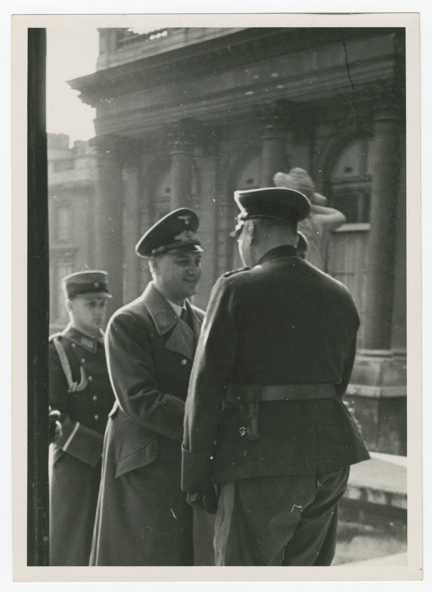 Alfred Rosenberg shakes hands outside the French National Assembly.