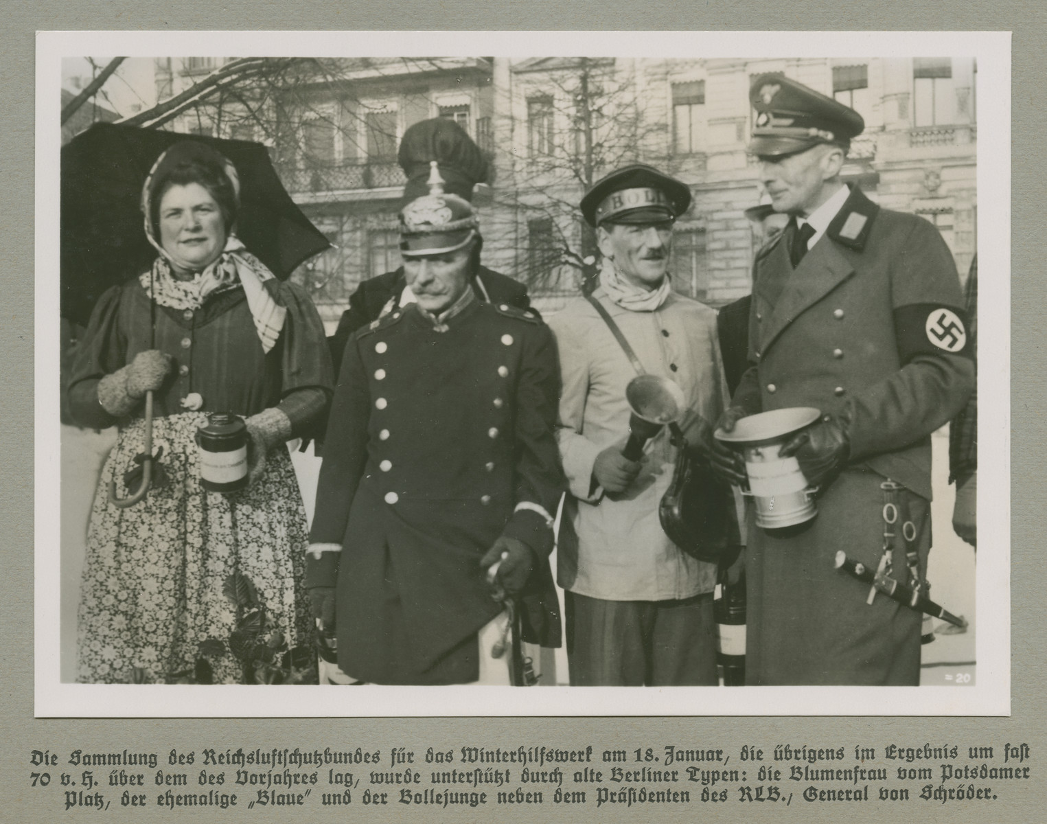 Group portrait of men and women dressed as typical Berlin character types.  Original caption reads: Gathering of the Reichluftschutzbundes (State Air Protection Corps) for the Winterhilfswerke (Winter Relief Drive) on January 18, which incidentally has increased by nearly nearly 70 percent  over the previous year, was supported by old Berlin types: the Flower Lady of Potsdamer Platz, the Former Blue Policeman and the Milk Delivery Boy stand next to General Von Schröder, the president of the RLB.