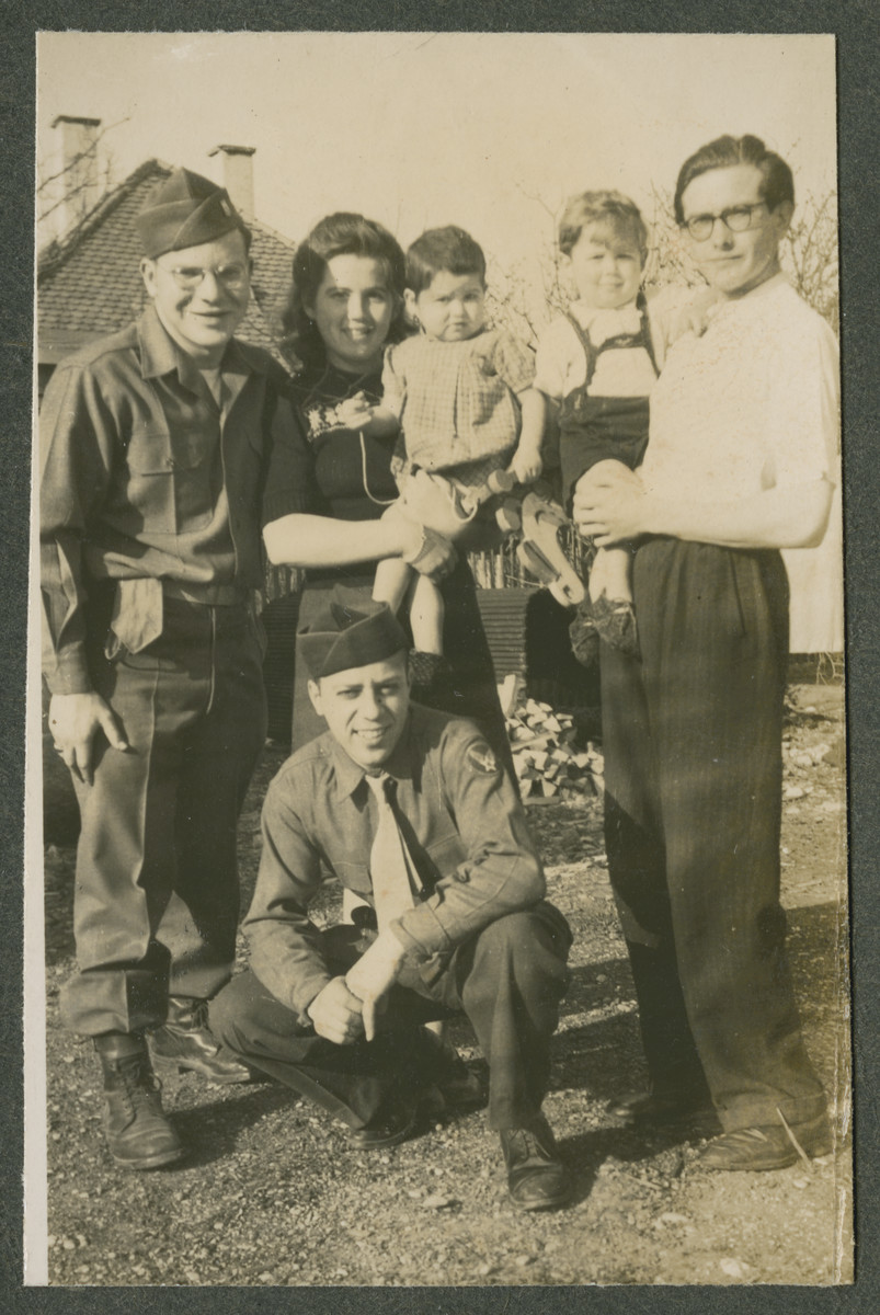 Herman Kutun (pictured on the far left) poses with a family of Jewish DPs in Garmisch.