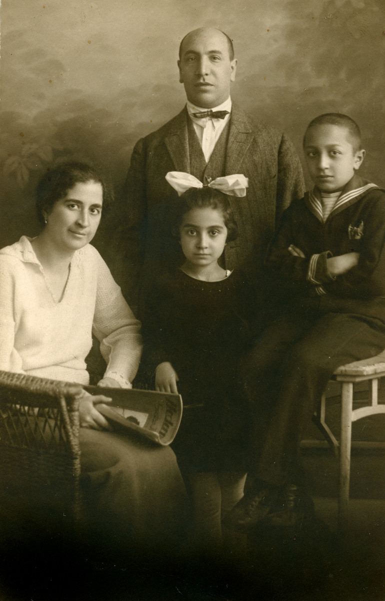 Studio portrait of the Kabillo amily.   Pictured are Albert and Blanka Kabilio and their children Ella and Sambul.