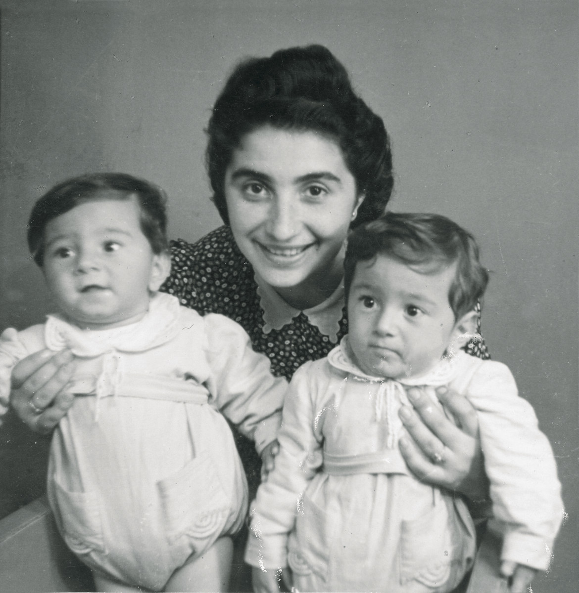 Ella (Kabilio) Finci holds her twin sons, Shmuel and Avraham.