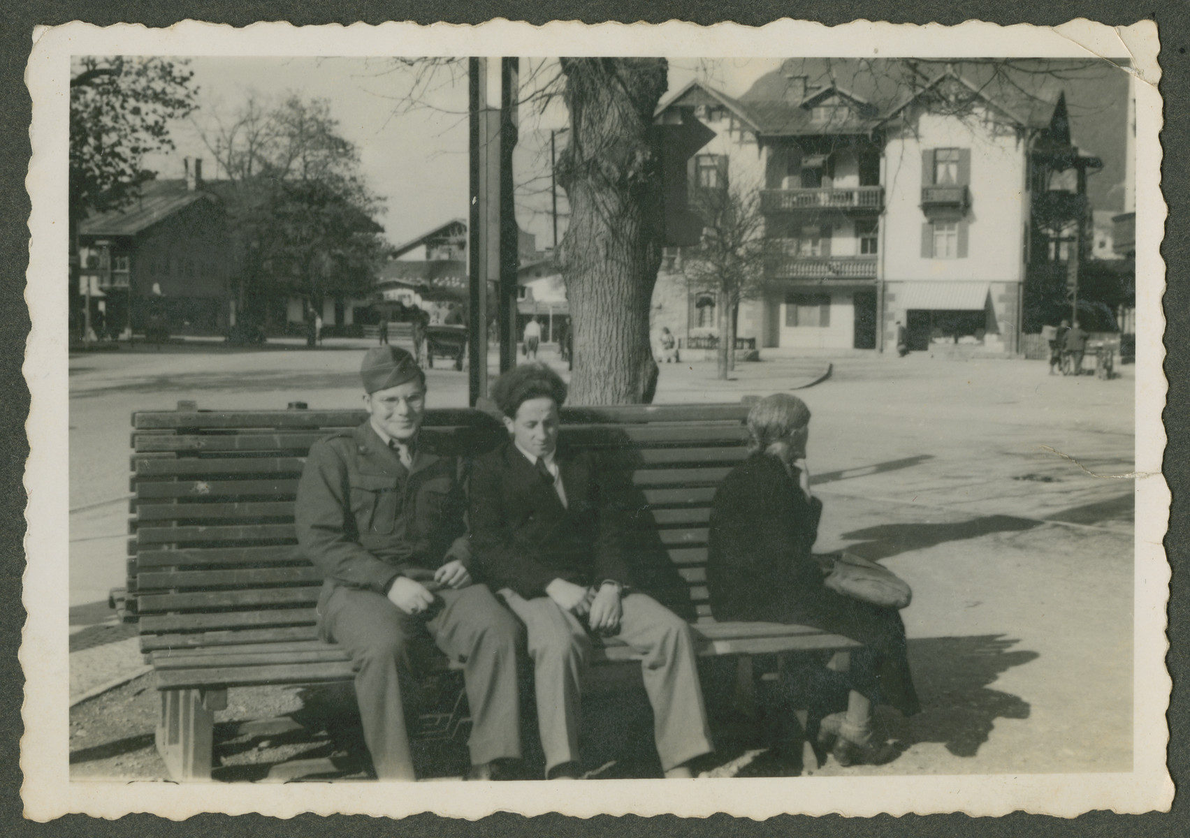 Herman Kutun sits with a a Jewish DP (probably a survivor from Dachau) who he had befriended on a bench, probably in Garmsich..