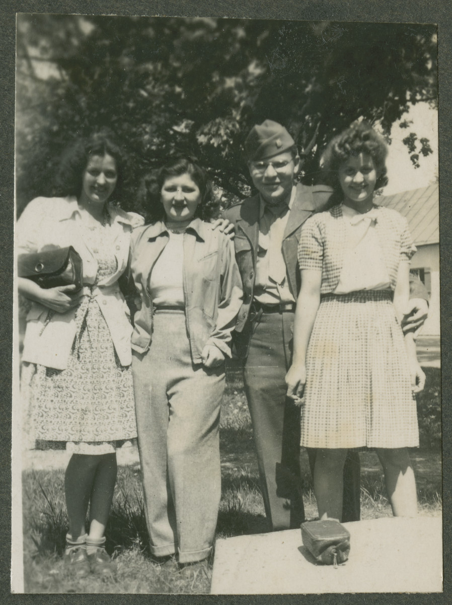 Herman Kutun poses with three female Jewish DPs, (probably in Garmisch).