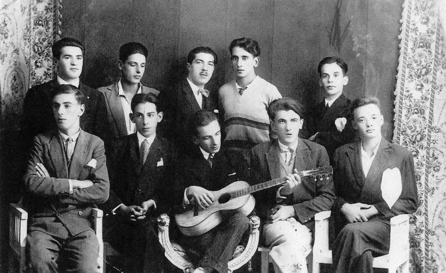 """A group of Jewish students, possibly called """"Benovolentsia"""",   Among those pictured are brothers Yechiel Finci (back row, far right) and Moshe Finci (front row, second from the left)."""