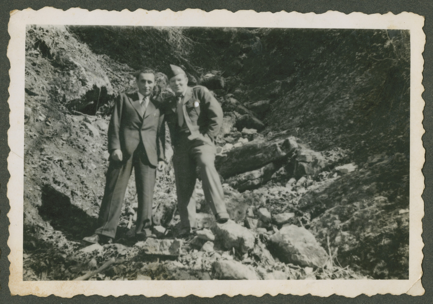 Herman Kutun stands with a a Jewish DP (probably a survivor from Dachau) who he had befriended.