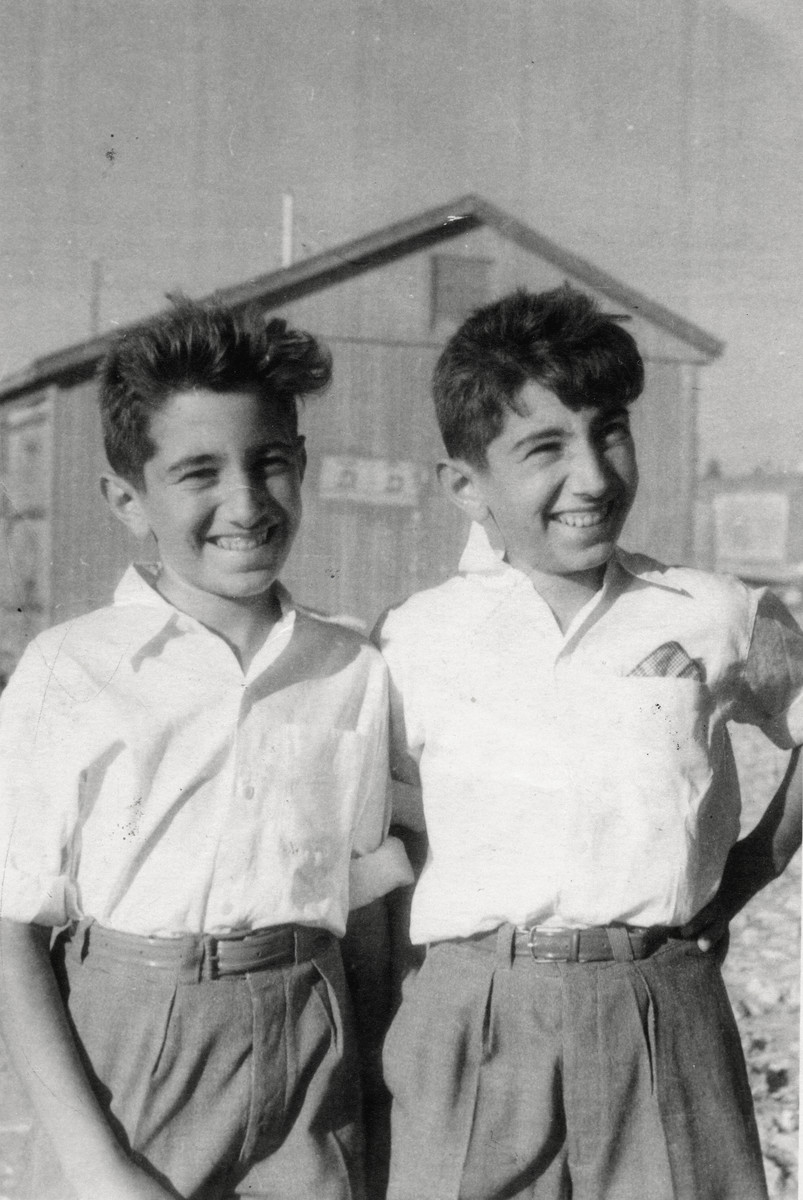 Close-up portrait  of 12 year old twin brothers Shmuel and Avraham Finci standing at the Talpiot Immigration Center in Jerusalem.