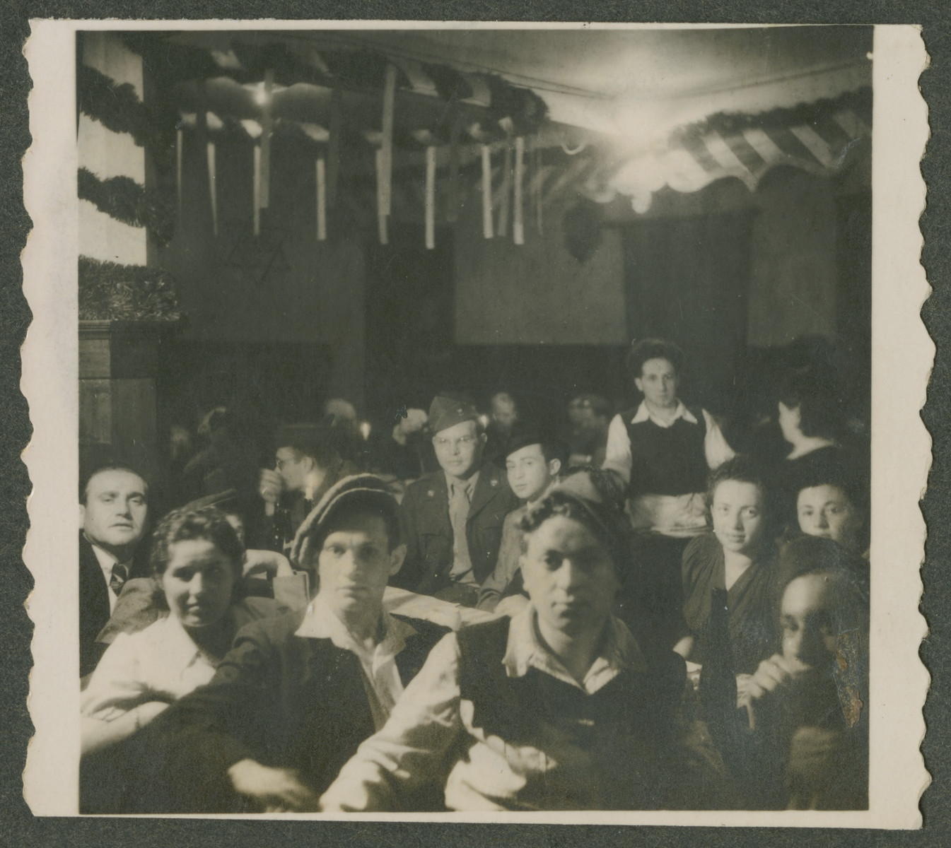 Herman Kutun joins Jewish survivors in the celebration of a holiday in the Garmisch displaced persons camp.