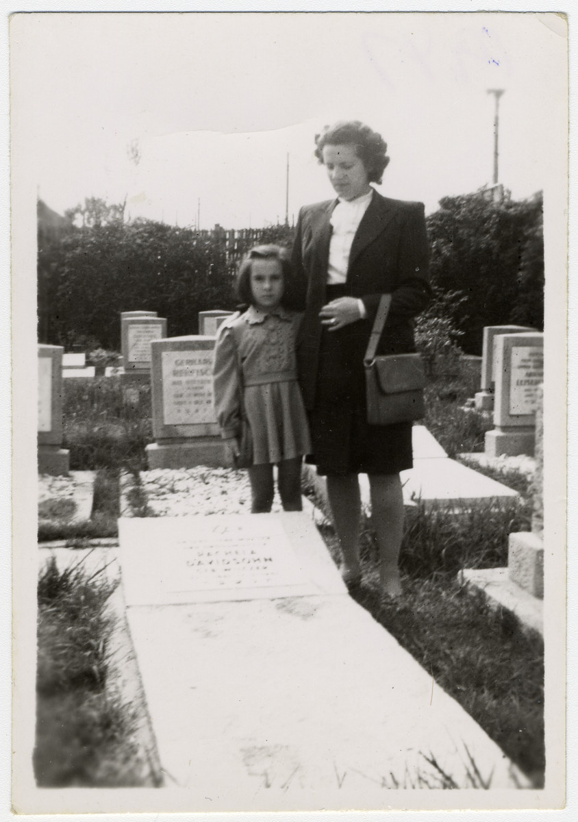 Klara and Helga Schneider visit the grave of their mother/grandmother, Rachela Davidson.