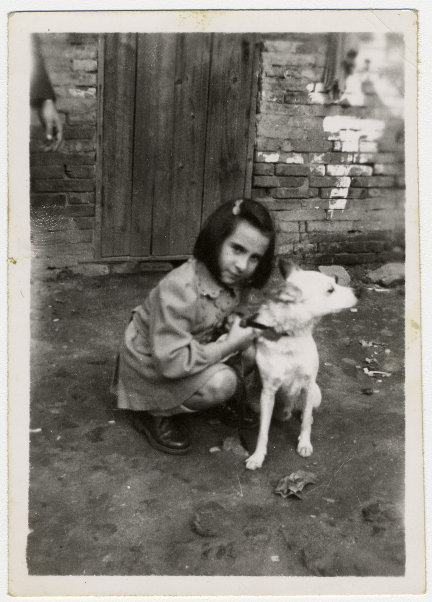 Helga Schneider poses with her dog Bobby on a street in Shanghai.