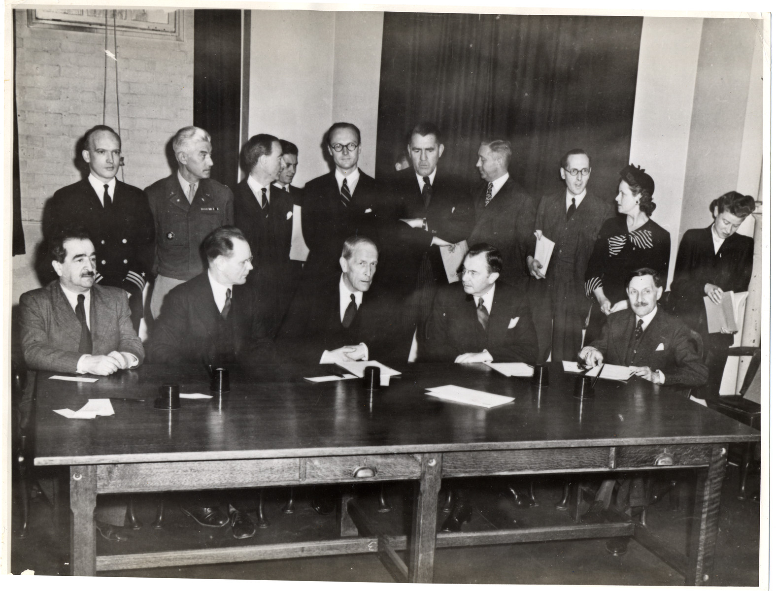 The members of the War Crimes Executive Committee at the signing of the agreement to create the International Military Tribunal to prosecute German war criminals.    Among those pictured are Major General I.T. Nikitchenko (second from the left) who will represent the U.S.S.R. on the Tribunal, Justice Robert Jackson (second from the right) who will be the chief U.S. prosecutor, and Robert Falco (right), who will be the alternate French member of the Tribunal.