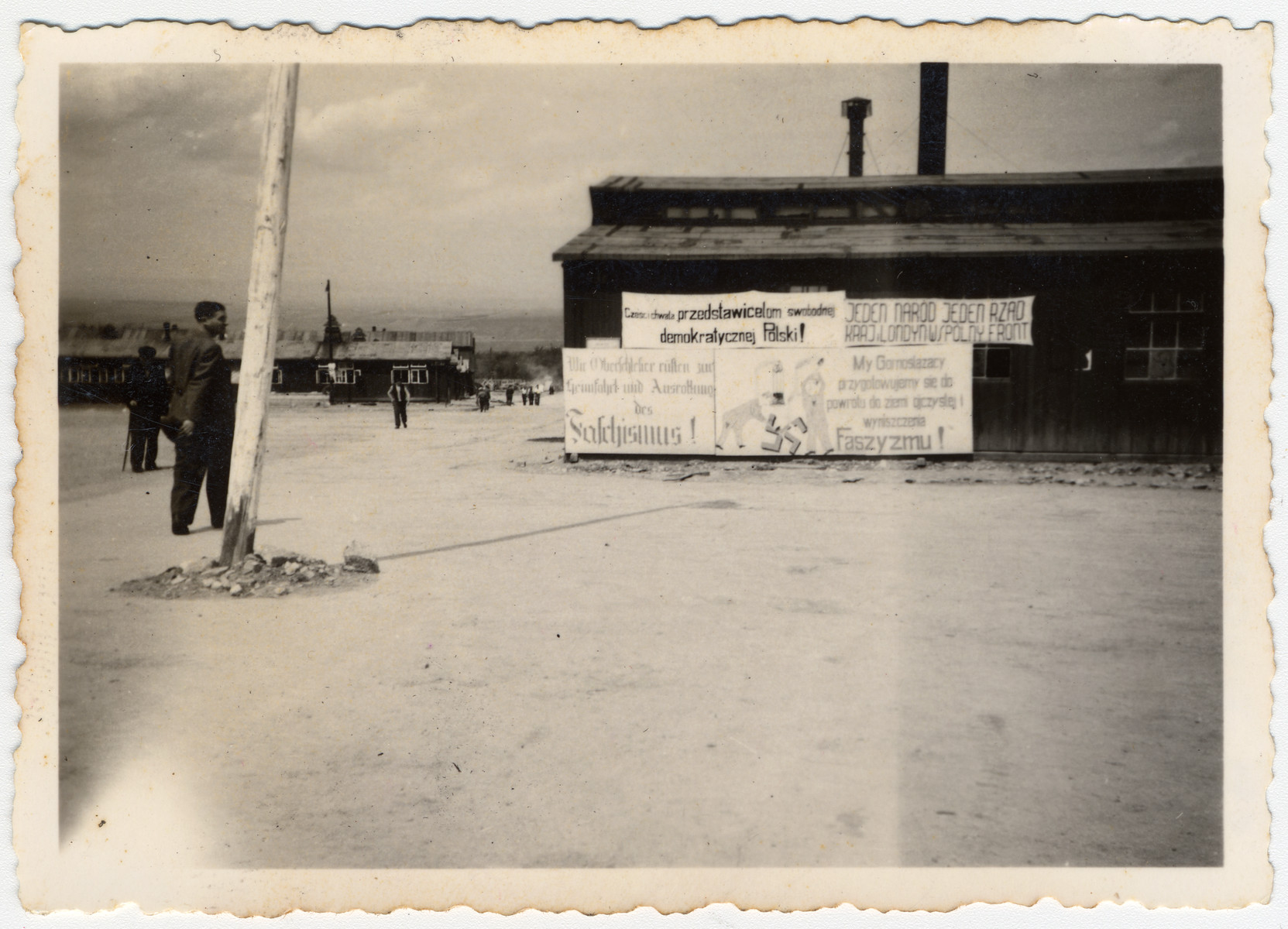 View of a barrack plastered with anti-Nazi signs in the Buchenwald camp, taken in June 1945.