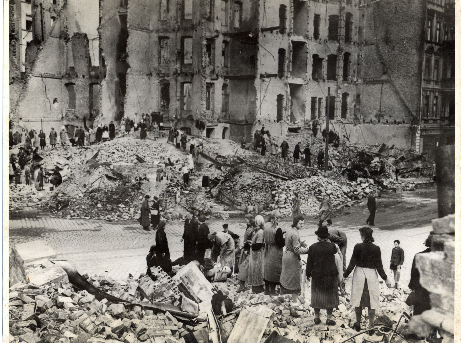 Women remove the rubble from the streets of Berlin.