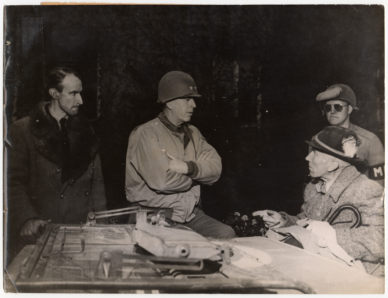 American troops capture Franz von Papen and his son.  Pictured from left to right: Captain Franz von Papen Jr., Major General Harry L. Twaddle, commanding general of the 95th Division of the 9th U.S. Army. and von Papen (in jeep). In the background is a U.S. Army military policeman.  Original caption reads :Franz von Papen Captured By U.S. Troops Count Franz von Papen, 67 year old German diplomat and Chancellor of the Reich before the Nazi regime, for which he became an outstanding ambassador and negotiator, was captured April 10, 1945, by troops of the 194th Glider Infantry Regiment of the 17th U.S Airborne Division in a hunting lodge of a baronial estate at Stockhausen near Hirschberg, 30 miles southeast of Hamm in the Ruhr area, during operations of the 9th U.S. Army to clear up the Ruhr pocket.""