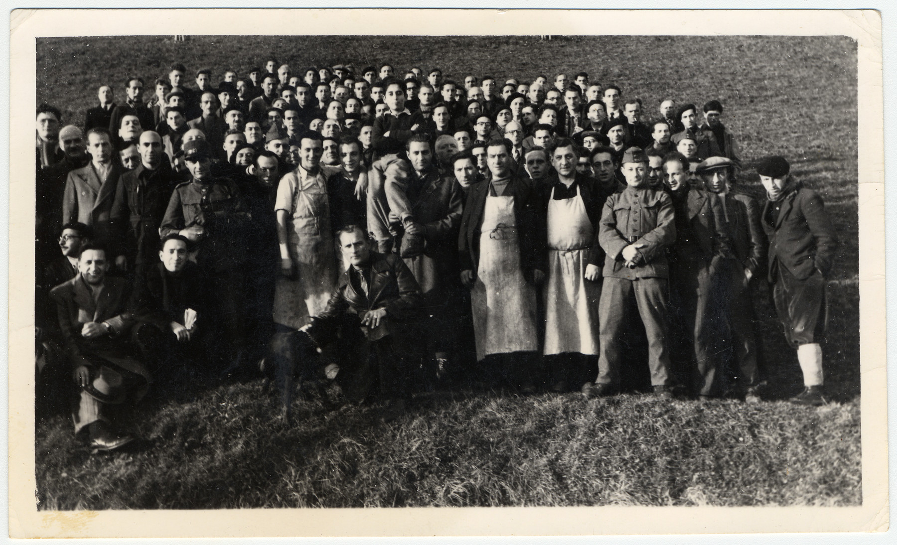 Group portrait of Jewish internees in an unidentified Swiss labor camp.  Max Schattner is standing in the first row on the far left.