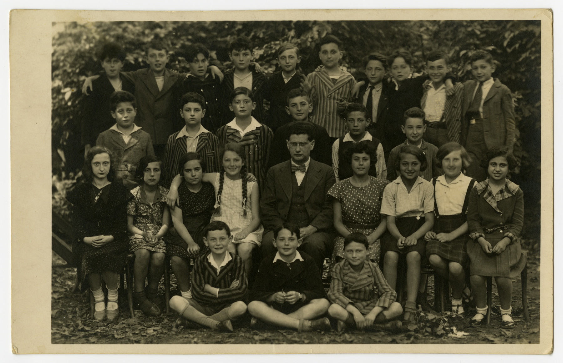 Class portrait of the Juedische Gemeinde Schule in Brno, Czechoslovakia.     Sali Berl, seated far left, was among the few survivors of her class.