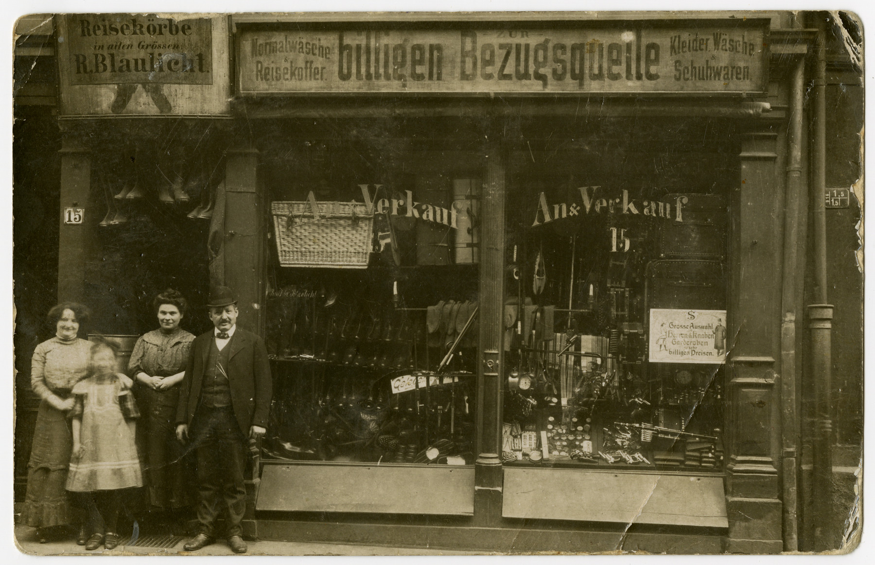 Members of the Blaulicht family, German-Jews of Polish ancestry, pose for a group portrait. in front of their general store.