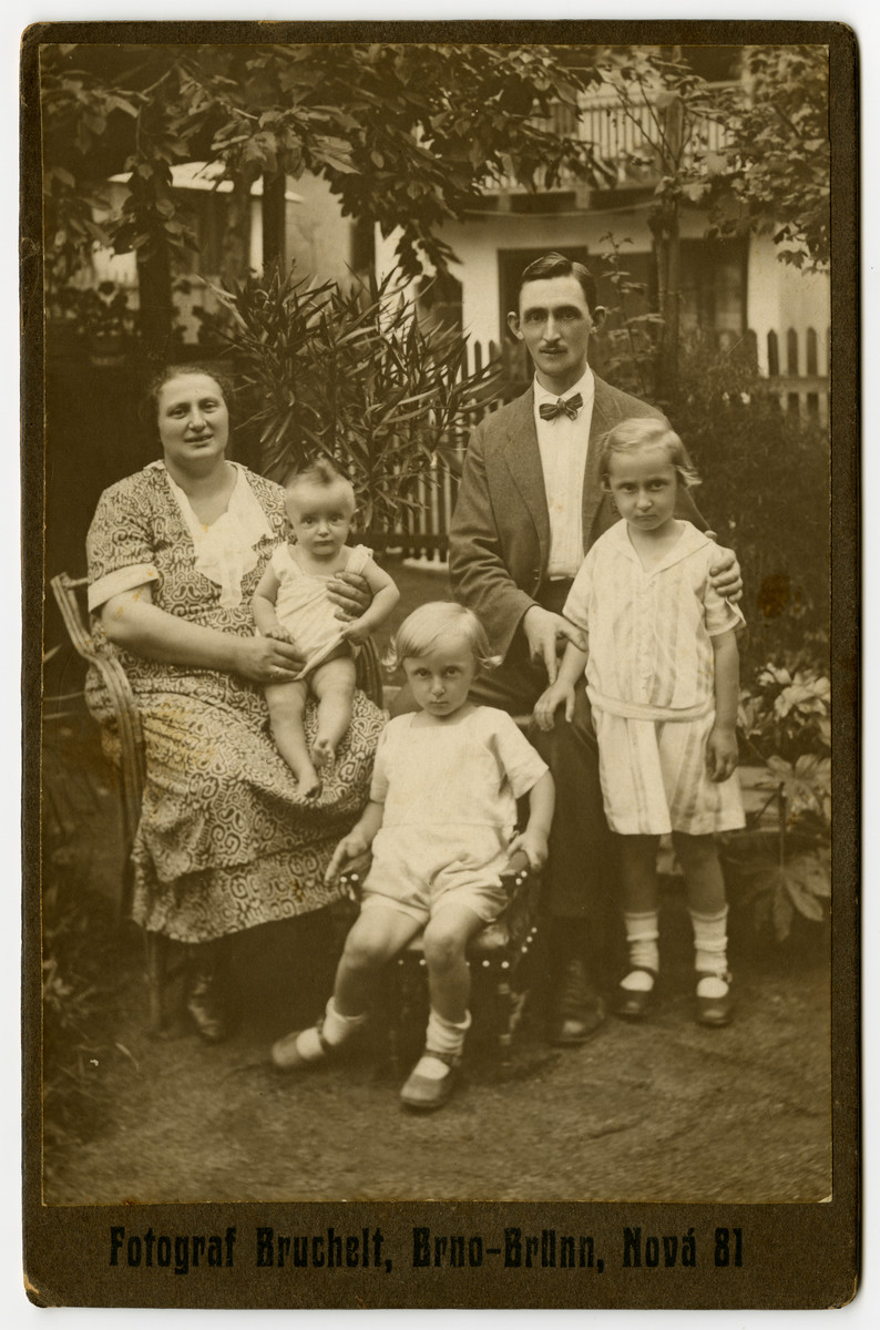 A Czech-Jewish family poses for a portrait in their garden.    Pictured are Helene and Herman Berl with their children, Sali, Leo, and Malvina.