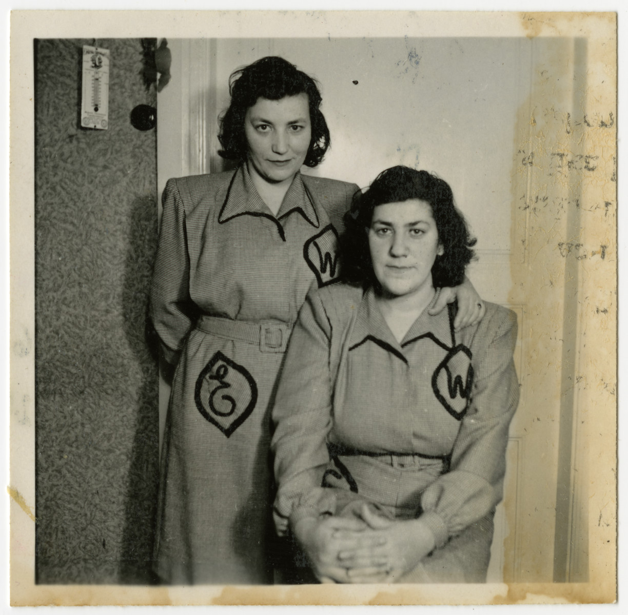 Czech-Jewish sisters pose in matching dresses while living as displaced persons in Sweden..    Together, sisters Elizabeth (Winkler) Reiss, left, and Sara (Winkler) Spitz, survived Auschwitz and Bergen-Belsen following their deportation from Berehovo in 1944.  In 1946 they immigrated to the United States.
