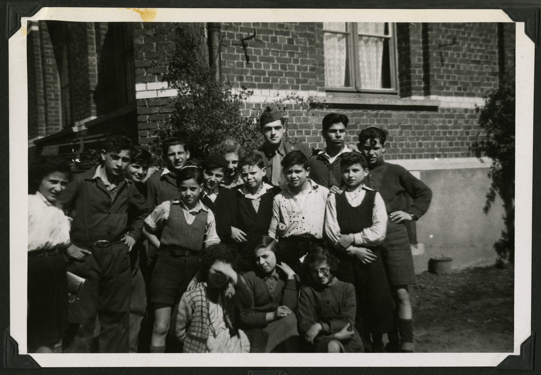 David Marcus poses with a group of Jewish children in Marquain, Belgium.