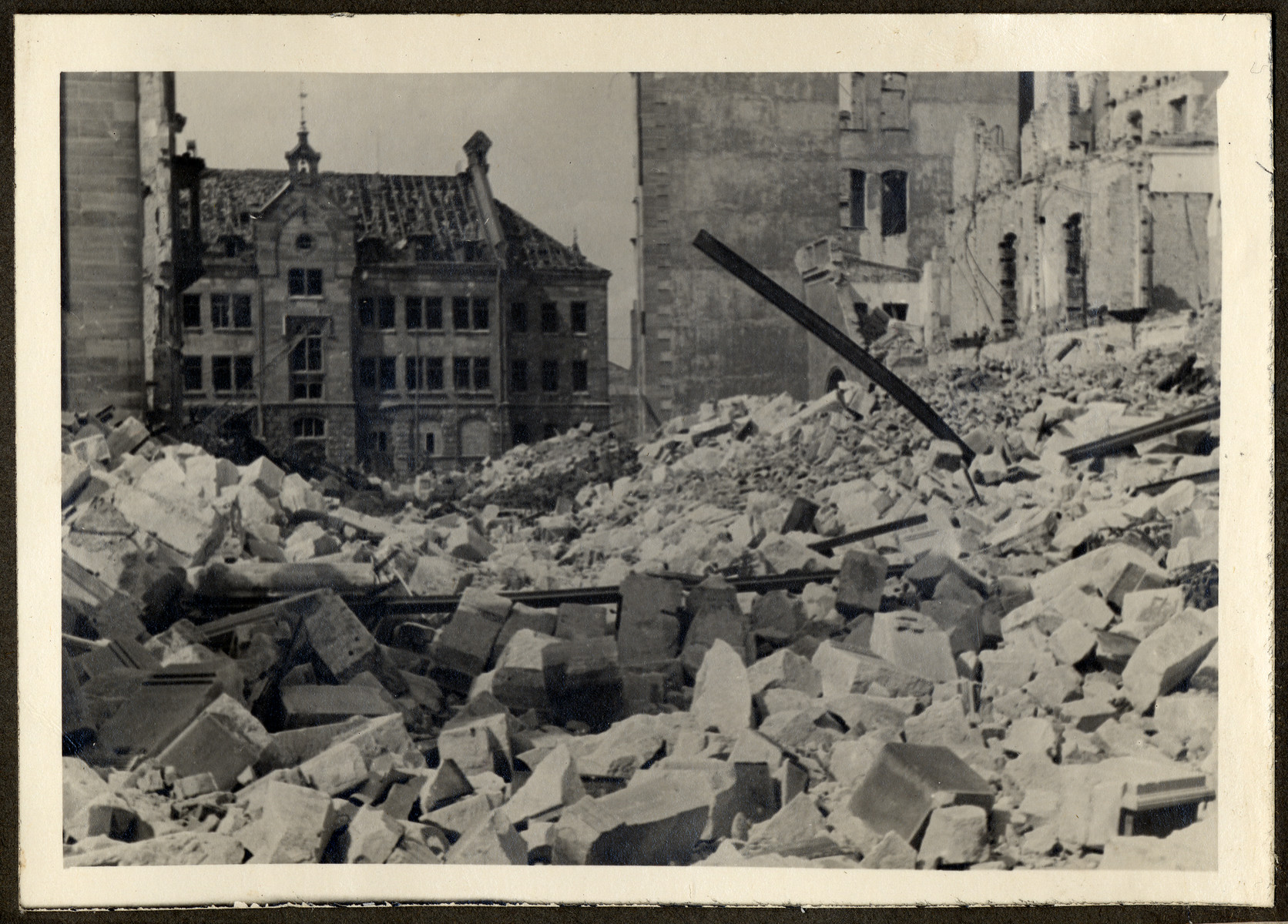 "Postwar view of a rubble-strewn bombed out street in Nuremberg.  The original caption reads: ""Of the Essenweinstrasse not even the street is left."""