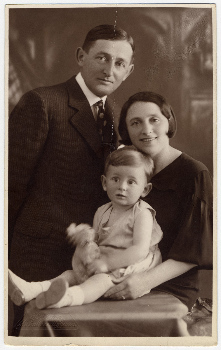 Studio portrait of Richard Brand with his parents, Moshe and Etel.