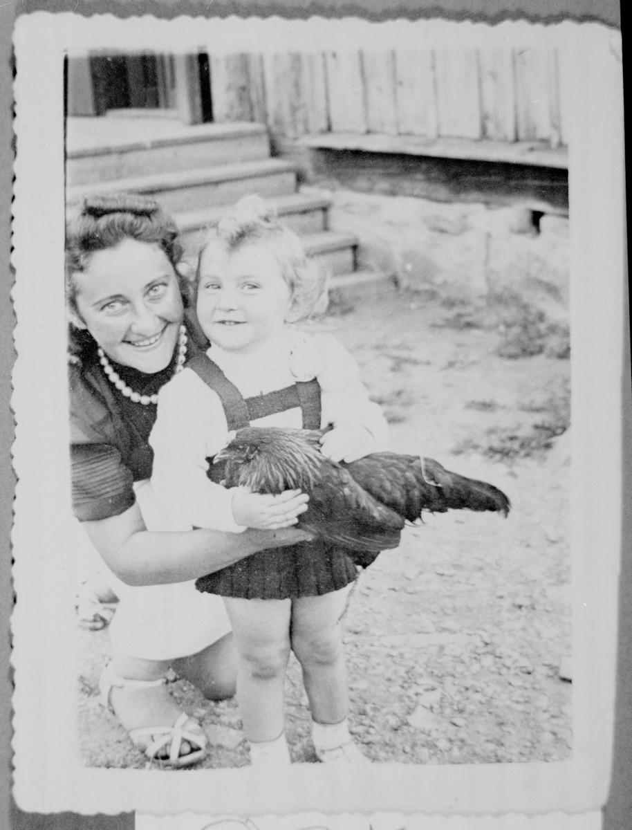 "Sharona Gorelitz holds a chicken while posing for a photograph with her mother Pnina ""Pepa"" Adlerstein."