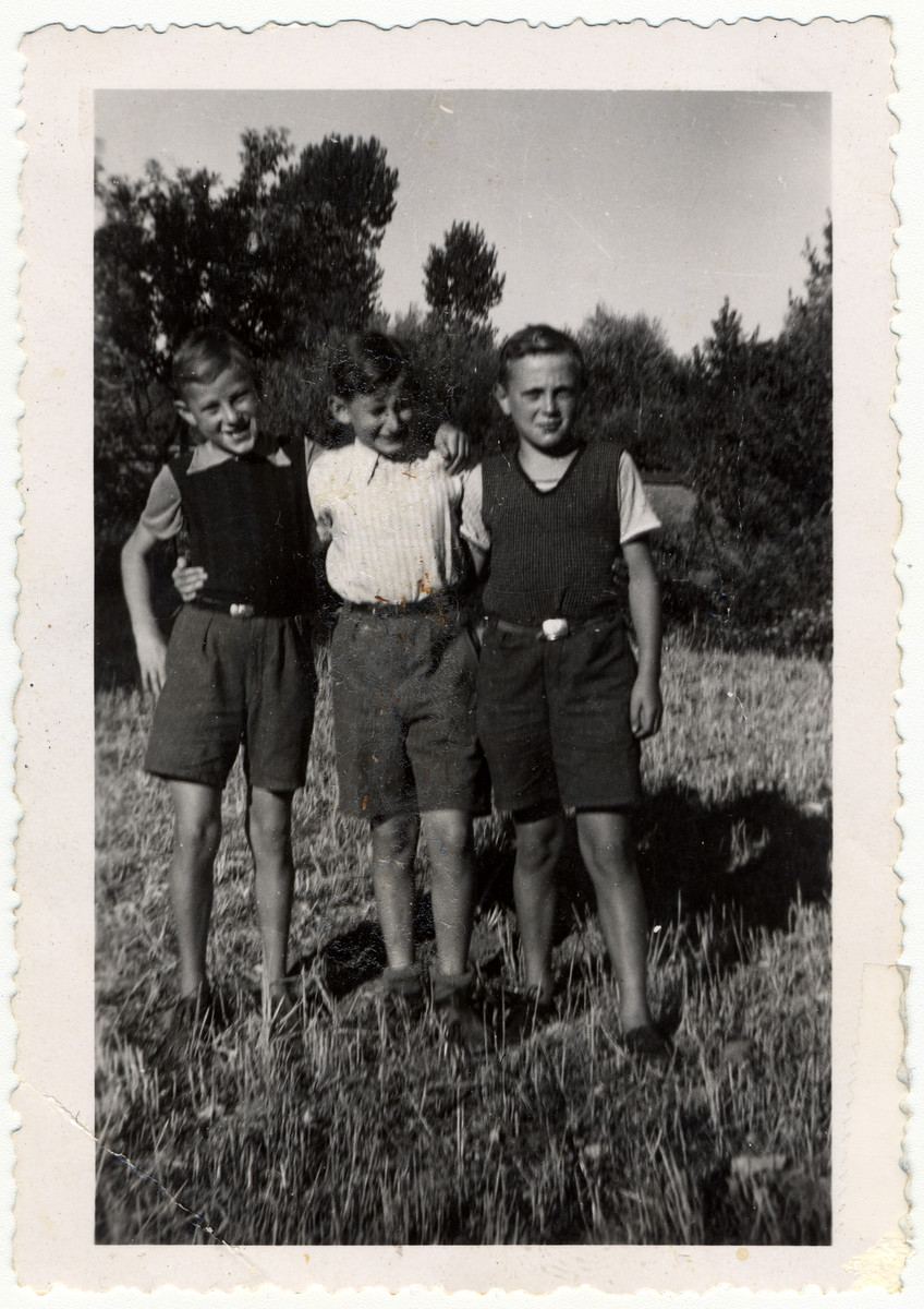 Alfred and Ernst Moritz pose with their friend Georges in a field in France after the war.