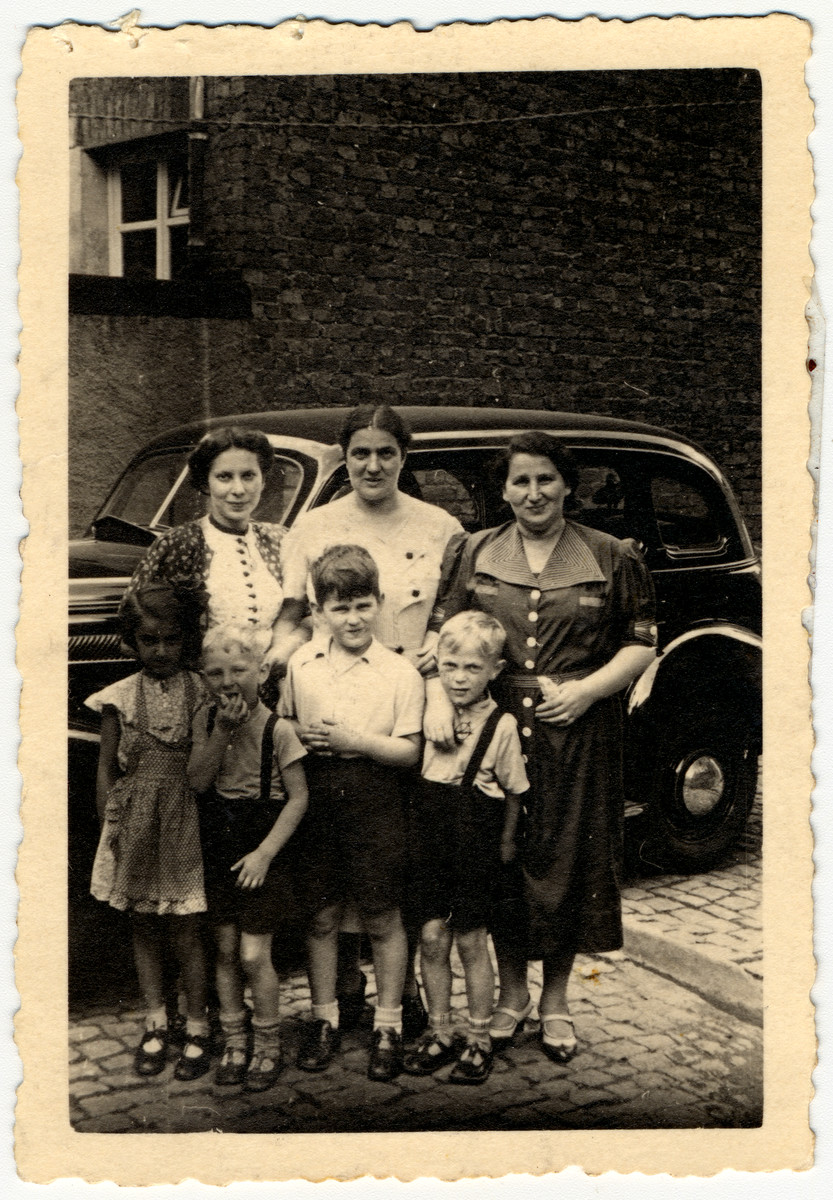 Group portrait of the extended Moritz family in Becherbach Germany.    Pictured front row: Liesel Moritz (later van Hoy), Ernst Moritz, Paul Hirsch and Alfred Moritz.  Second row: Elsie Wolf, Erna (nee Strauss) Moritz and Else (nee Moritz) Hirsch.