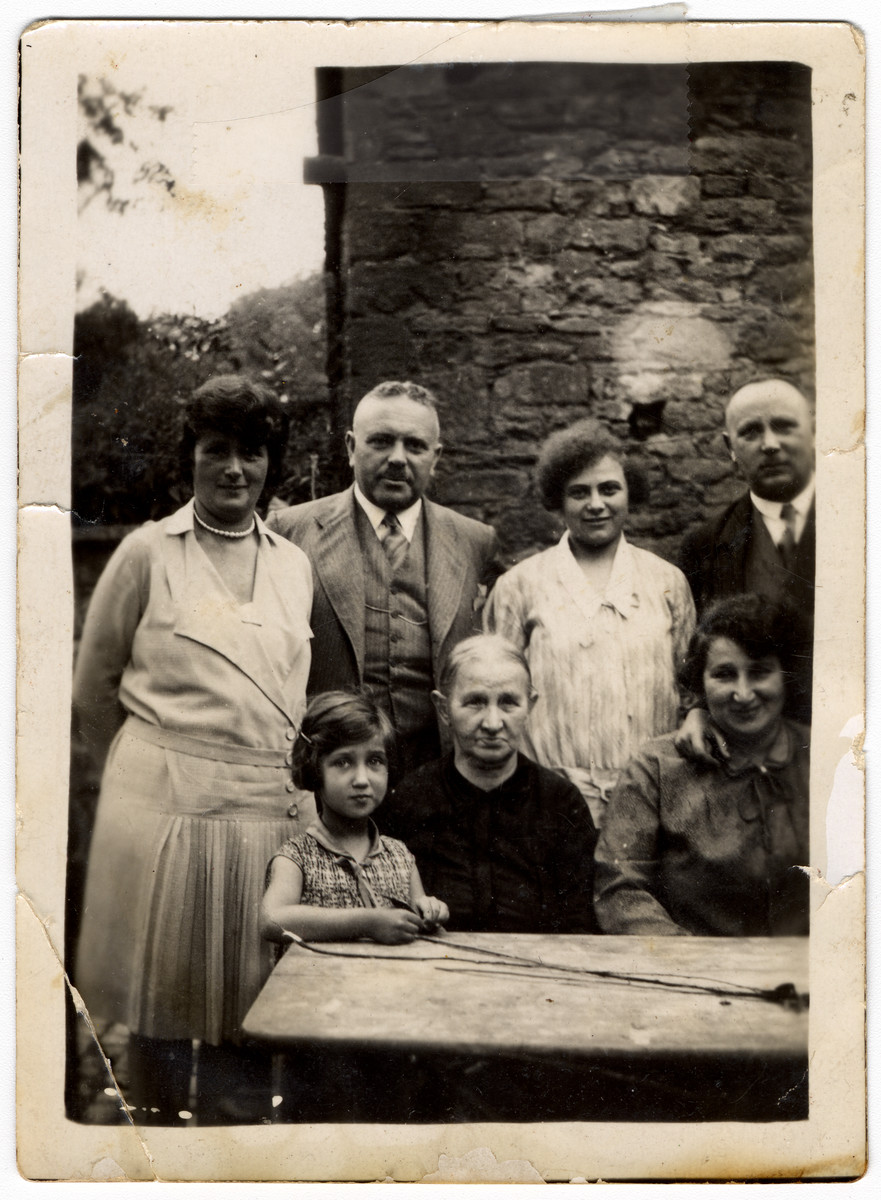 Prewar portrait of the Moritz family seated by an outdoor table in Becherbach.  Seated are Lotte Moritz (later Garber, cousin of the donor), Regina Wendel Moritz, and Else Moritz Hirsch.  Standing are Paula Moritz Loeb, Julius Loeb, Klara Kaufmann and Ludwig Moritz.