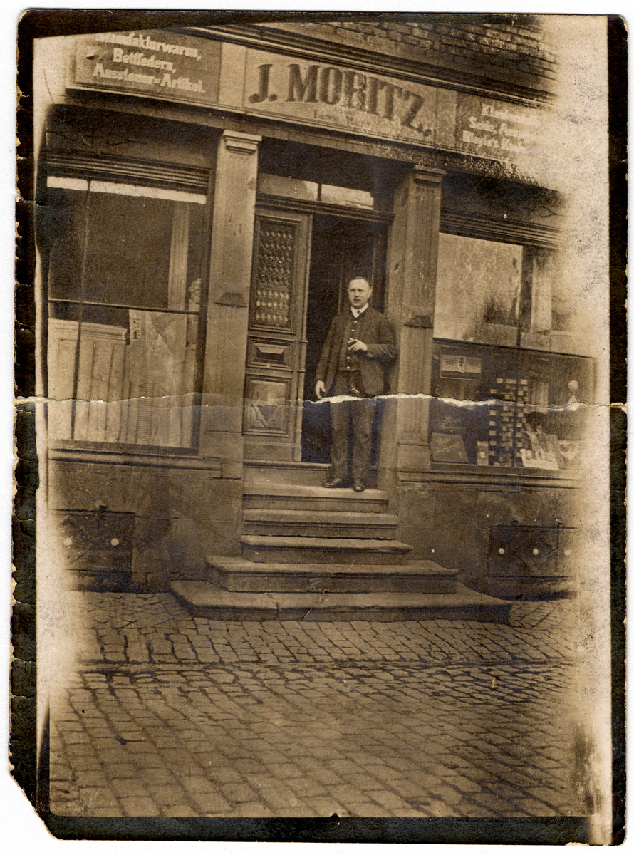 Ludwig Moritz stands by the entrance to his store.