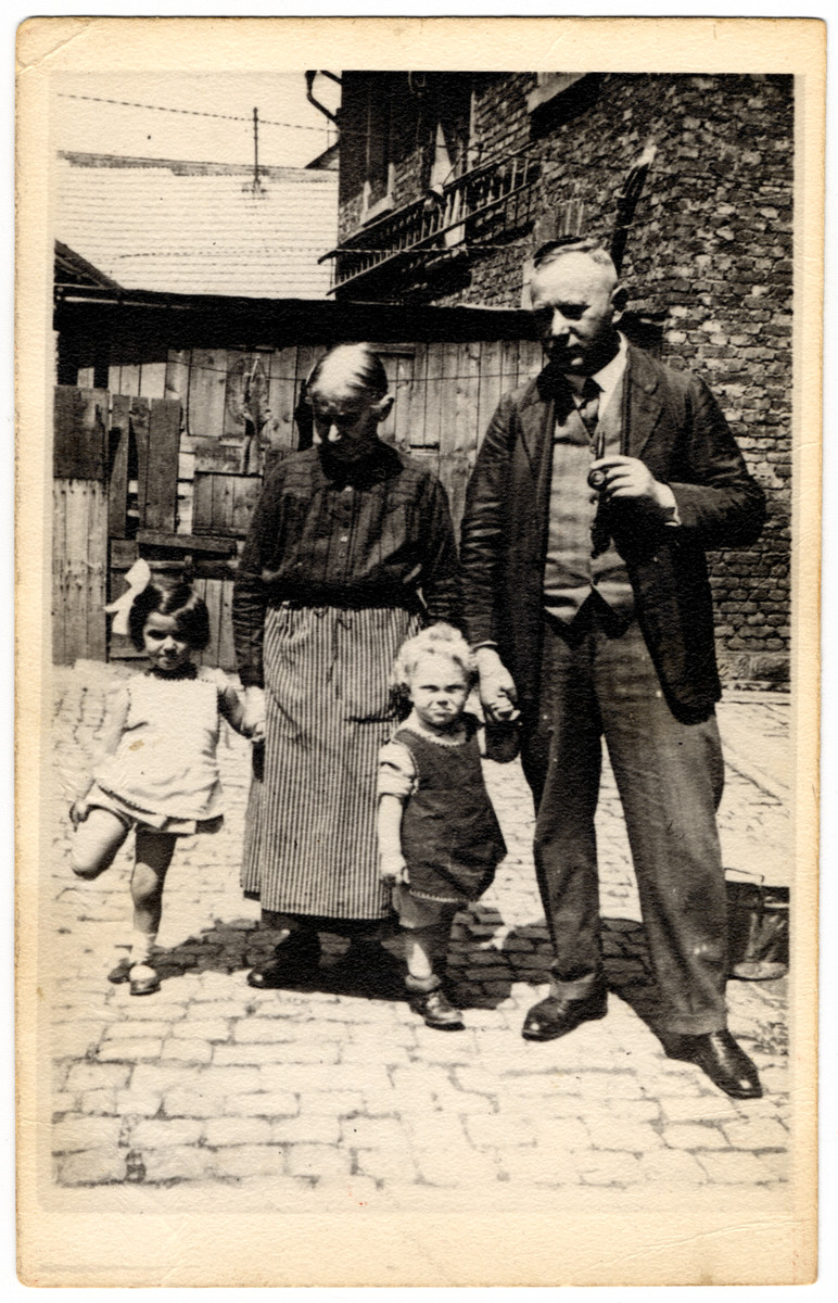 The Moritz family poses in an outdoor courtyard.  Pictured are Liesl (a cousin of the donor), Regina Wendel Moritz  (grandmother of the donor), Alfred Moritz and Ludwig David Moritz.