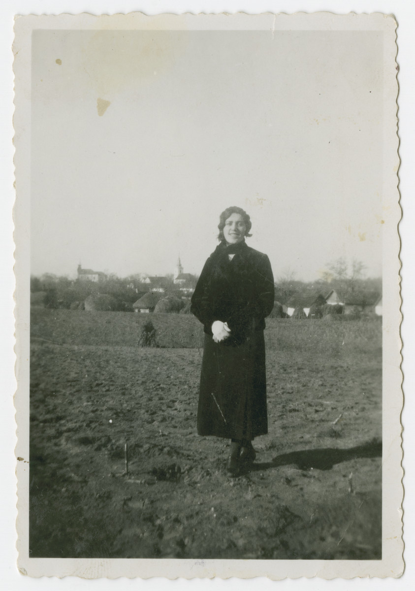 Rosa Klein stands in a field in prewar Hungary.  She later perished in Auschwitz.