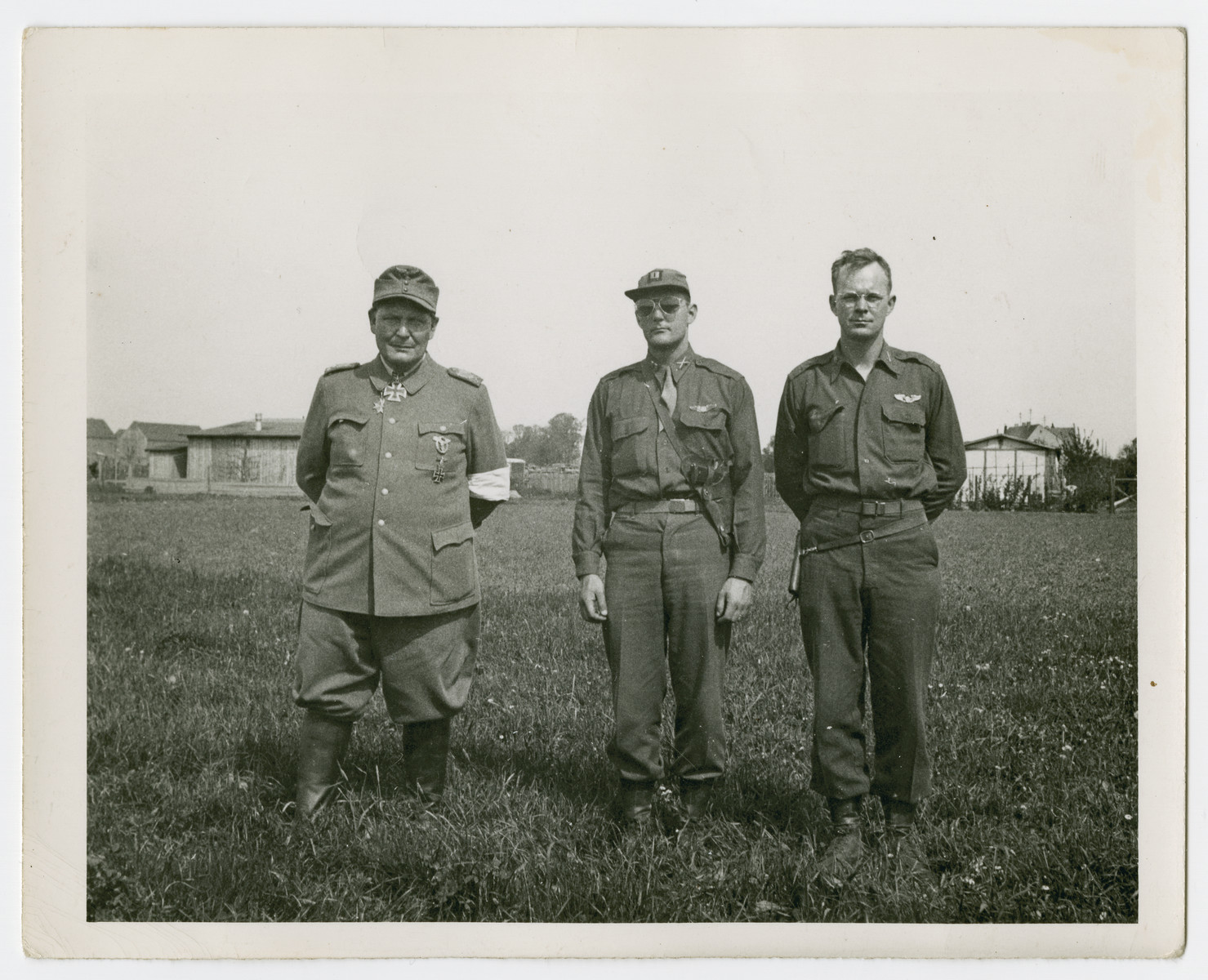 Herman Goering poses with two American soldiers shortly after his capture.