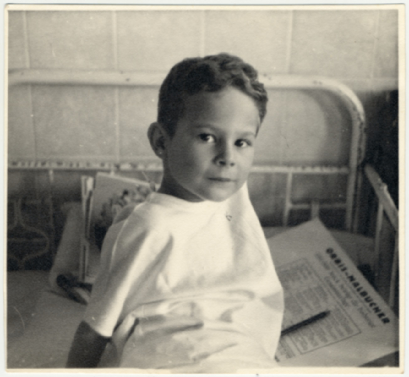 Robert Wagemann, a physically disabled Jehovah's Witness child, sits on his hospital bed.
