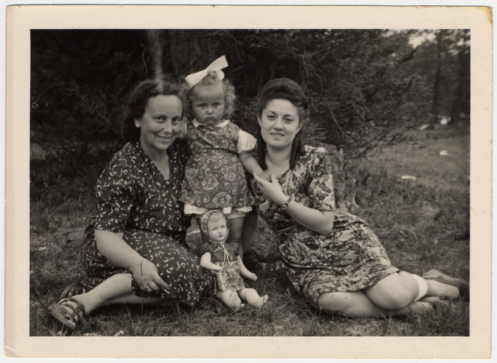 """Shulamit Perlmutter (right) poses with another woman and her young daughter before she leaves for America.  The original caption reads """"To Dear Muszka, So that she should remember that we love her and ask her not to forget us, even in America.  Ania and Sala""""."""