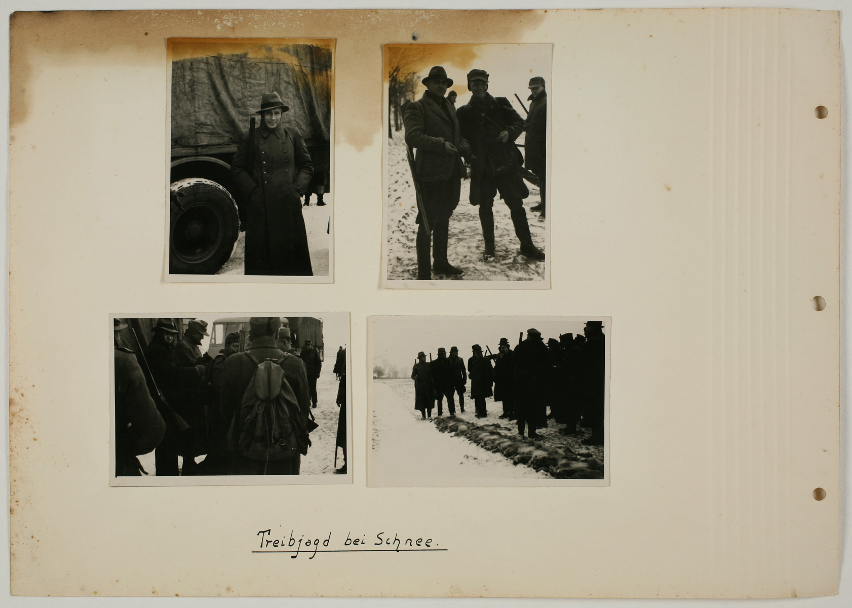 "One page from an album created by adjutant to the commandant Karl Hoecker, depicting SS activities in and around the Auschwitz concentration camp.  The original caption reads ""Going hunting in the snow""."