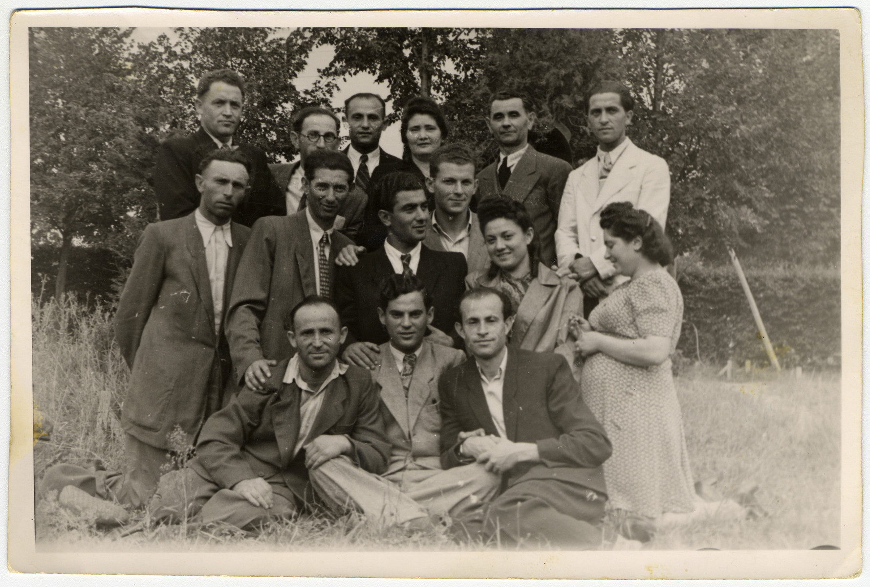 "Group portrait of Jewish displaced persons.  Shulamit Perlmutter is pictured second from the right in the second row.  The original caption reads ""To Shulamit for eternal memory from Gregory Nudelman."""