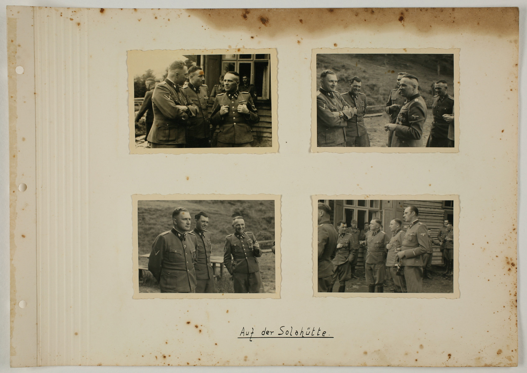 """One page from an album created by adjutant to the commandant Karl Hoecker, depicting SS activities in and around the Auschwitz concentration camp.  The original caption reads """"At Solahuette""""."""