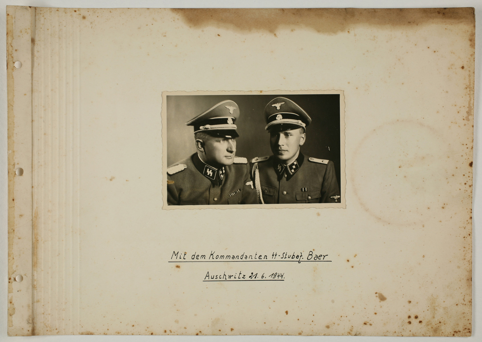 "One page from an album created by adjutant to the commandant Karl Hoecker, depicting SS activities in and around the Auschwitz concentration camp.  The original caption reads ""With the Commandant SS Stubaf. Baer, Auschwitz 21.6.44."""