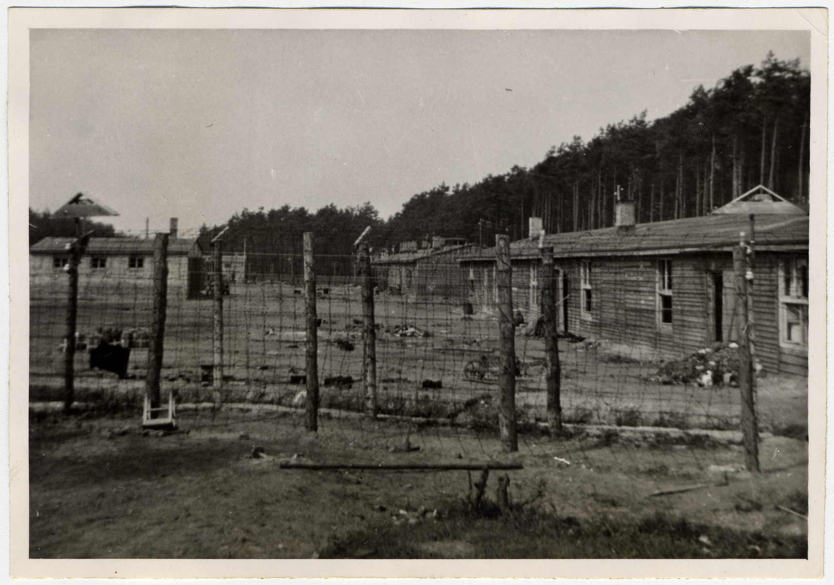 View of the fence and barracks in the Woebbelin concentration camp.