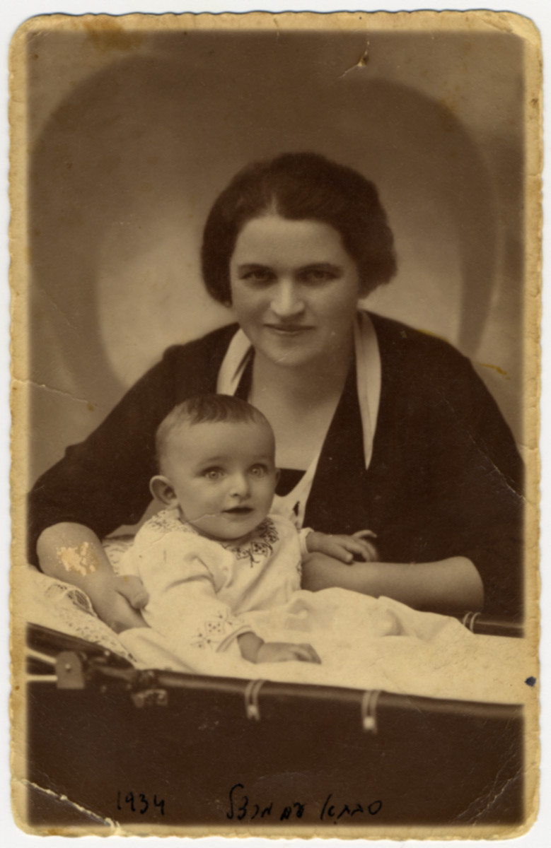 Studio portrait of Laura and her infant son Marcel.   The original caption on back of photo reads: To dear parents as a reminder from Jakob, Laura, and Marceli  August 1934.