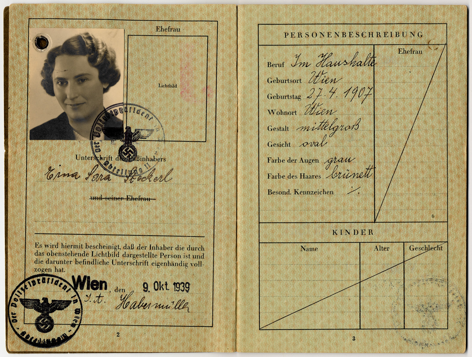 """Passport with a red """"J"""" and the imposed middle name """"Sara"""" issued to Erna Steckel."""