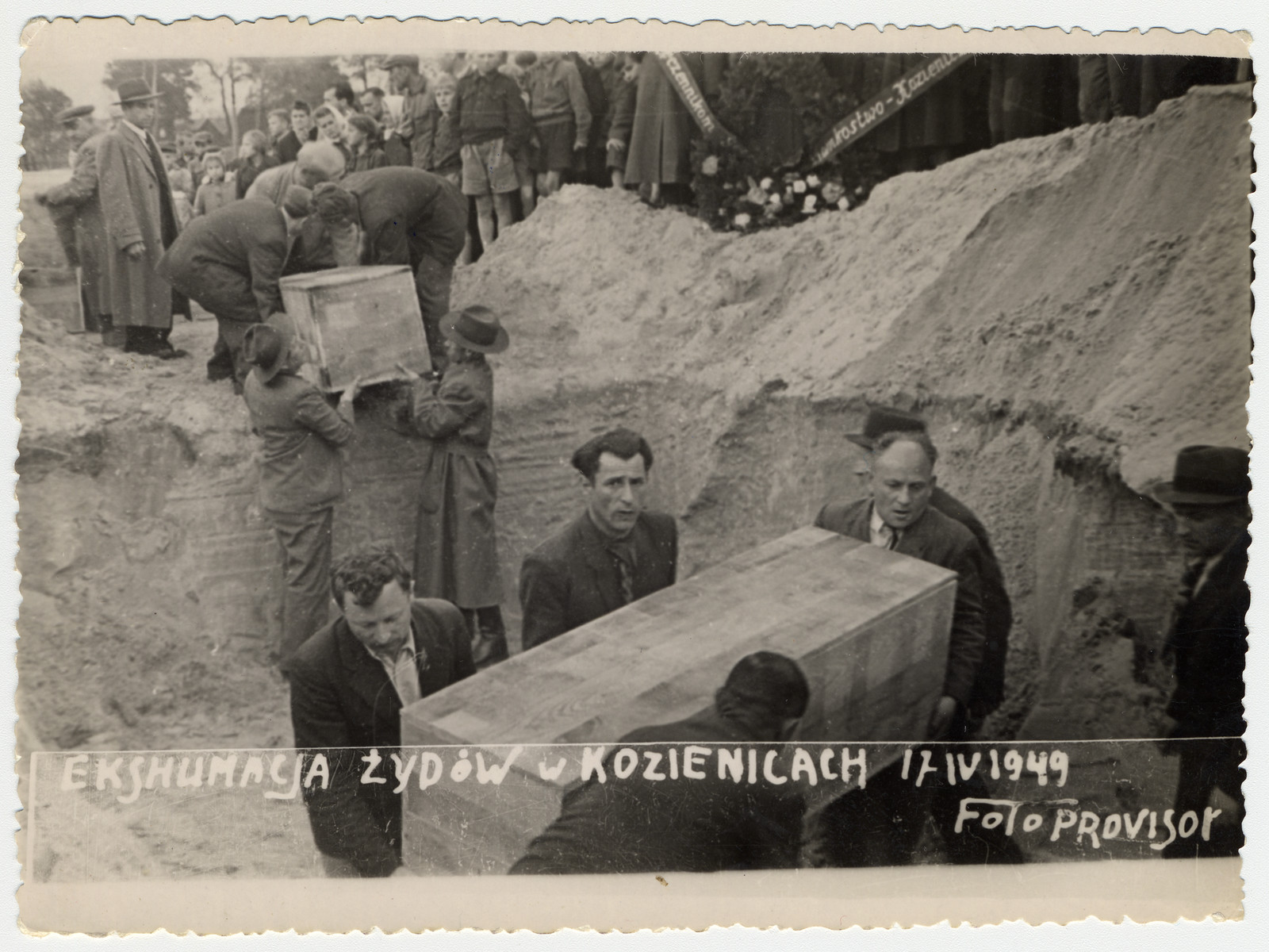 Survivors from Kozienice exhume and rebury victims killed by the Nazis.